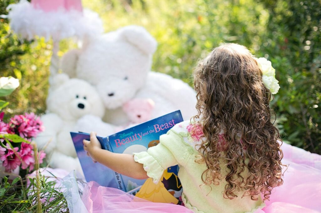 kid-playing-and-reading-fairytales