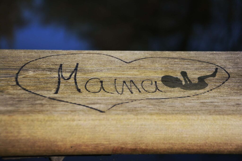"""A written """"mama"""" on a bench"""